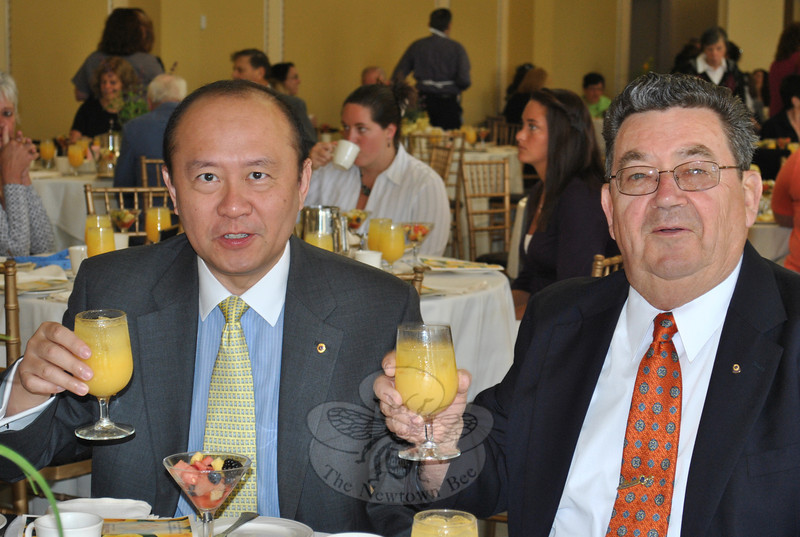 Newtown Lions Club members Jason Hsu, left, and Richard Kovacs toast the success of the June 8 Newtown Chapter Regional Hospice thank you breakfast. The Lions were a corporate sponsor of the event.  (Crevier photo)