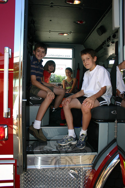 Four students who attend Sandy Hook School had a very special ride to school Tuesday morning. James and Julia Doyle and Garrett and Madison Fetchick were picked up at the Doyle home on June 8 and driven to school in Sandy Hook Fire & Rescue Company's brand-new 2010 Pierce Engine. (Hicks photo)