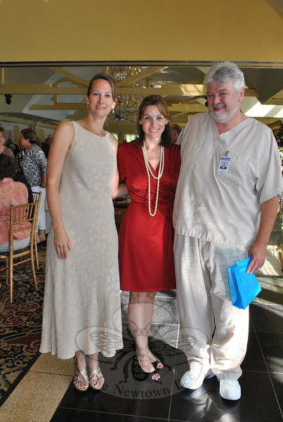 Dr Jo-Ann Soltis, palliative care physician at Danbury Hospital, left, and Cynthia Roy-Squitieri, executive director of Regional Hospice of Western Connecticut, center, join certified nurses' aide Gerard Lamoureux at the 21st Annual Regional Hospice Fundraiser/Thank You Breakfast on Tuesday, June 8. Mr Lamoureux was this year's guest speaker.  (Crevier photo)