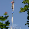 Paul Bastiaanse spent much of Monday, June 7, working on the historic Main Street flagpole.  (Hicks photo)