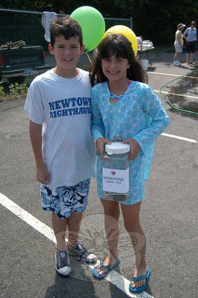 Lyle Vetare, left, and sister Sophia held a donation box for funds at a benefit car wash and auto clinic held at Berkshire Motors, 25 Berkshire Road in Sandy Hook, on Saturday, June 5. Donations were accepted during the event for both the car wash and the inspection of belts, hoses, antifreeze, fluids, batteries, tires ,and lights. All proceeds went to benefit Newtown Parent Connection.  (Hallabeck photo)