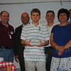 NHS senior Robert Mayer holds the special trophy awarded NHS business partner Tier One on Thursday, June 3. Looking on, from left, are Tier One manager Jim Bailey, NHS Principal Charles Dumais, Tier One owner Mike Iassogna, NHS employment specialist Marcia Crocetto, and Tier One owner Rick Hall. Robert interned with Tier One this past school year and has accepted a full-time position with the Newtown company following graduation.  (Crevier photo)