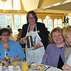 From left, Darlene Dodson, Madeline Bunt, and Kerry Gulick enjoy their breakfasts while Union Savings colleague Peggy Velthuzen offers coffee. Union Savings was one of four corporate sponsors.  (Crevier photo)