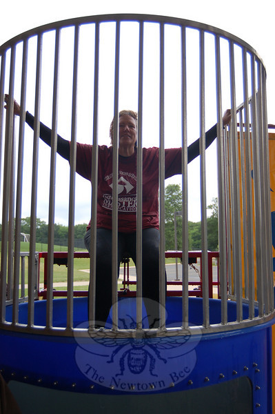 Reed Intermediate School library/media specialist Virginia Snowden took her turn in the dunk tank to celebrate the more than 22,000 books students read during the school year.   (Hallabeck photo)