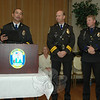 Police Patrol Officer Jeffrey Silver, right, received the Newtown Police Department's Award For Bravery at a recent ceremony held in Edmond Town Hall. Mr Silver was given the award for his August 2008 actions that helped resolve a tense situation in which a young man was holding his parents at knifepoint in their home. Many other police officers also received awards at the event. Standing next to Mr Silver is Police Chief Michael Kehoe. Captain Joe Rios is standing at the lectern.  (Gorosko photo)