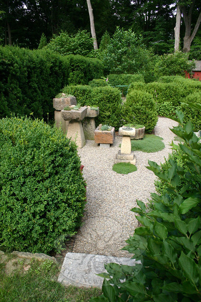 "Jean Sander has created what she calls a ""troughery"" within one of three garden rooms in her formal English garden.  (Hicks photo)"