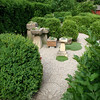 """Jean Sander has created what she calls a """"troughery"""" within one of three garden rooms in her formal English garden.  (Hicks photo)"""
