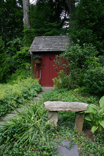 A three-seater outhouse is one of the first things visitors see when they enter the backyard of Jean and Lincoln Sander.  (Hicks photo)