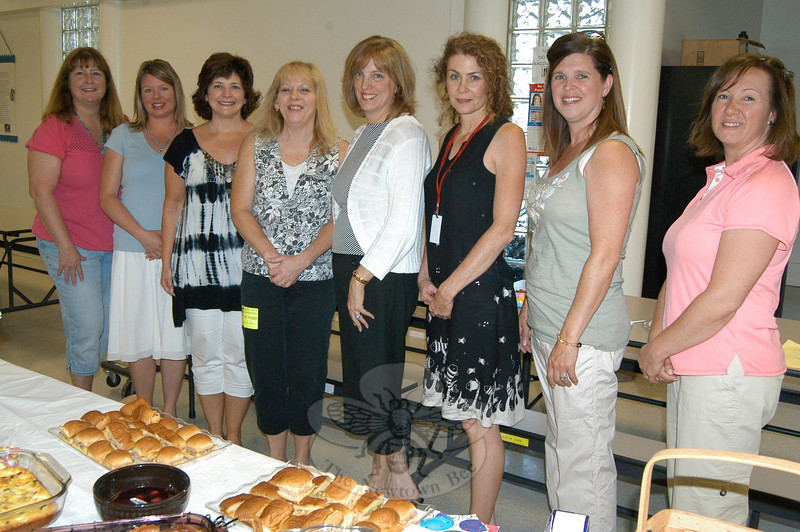 The final meeting of the Middle Gate PTA for the 2009-10 school year was held Wednesday, June 7, and included a breakfast to honor Principal Judy Liestman, who will be leaving the district at the end of the school year. Ms Liestman, fourth from right, stood with PTA members during the meeting.  (Hallabeck photo)