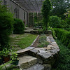 A sloping yard is what Jean and Lincoln Sander were dealing with when they purchased their home and property at 211 Walnut Tree Hill Road in late 2002. Reusing stones that were dug up from the back yard and creating a patio of the home's kitchen was one of the first things the couple did to establish their back yard.  (Hicks photo)
