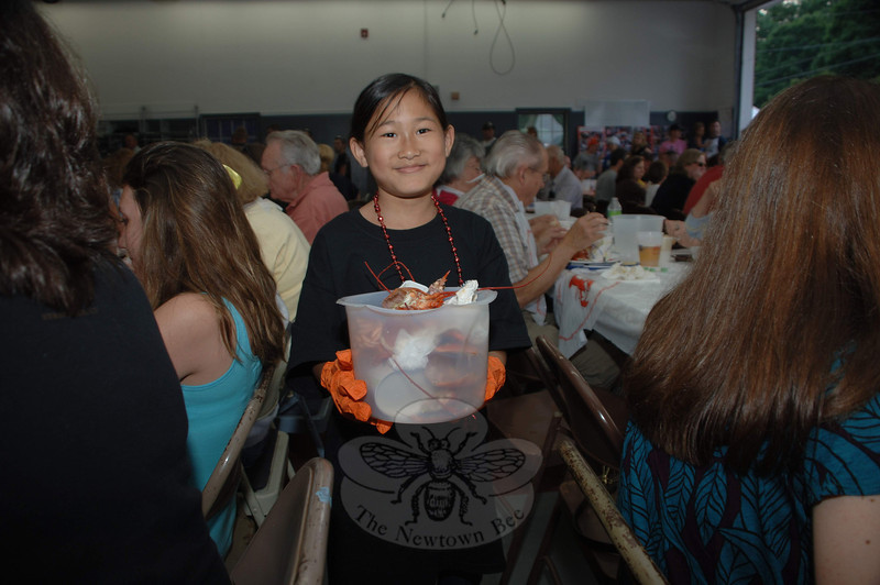 Amanda Brinkman, whose dad Dennis is a member of Sandy Hook Fire & Rescue, helped clear tables during the company's 23rd annual Lobsterfest. (Bobowick photo)