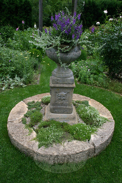 Jean Sander coupled an antique planter she has had for more than 15 years with a recent acquisition, a set of antique stones that were recovered from a 19th Century estate in Maine. The groundcover is two different types of thyme, while Jean has filled the planter with angelonia and miniature licorice plants.  (Hicks photo)