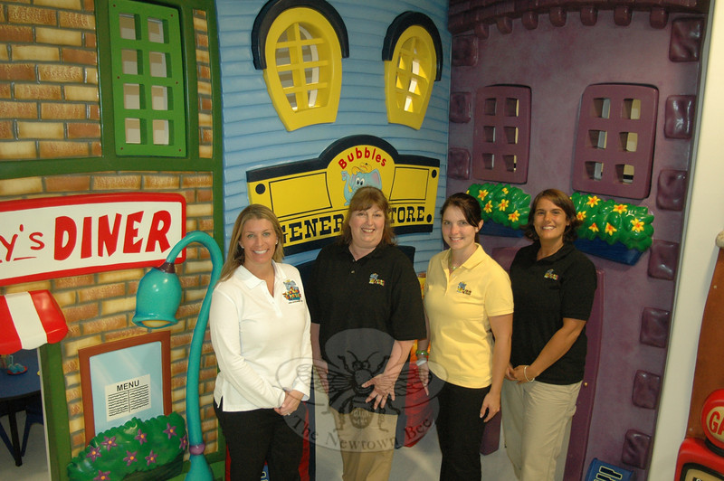 The Learning Experience Daycare Center is open providing a unique mix of fun and education in Plaza South at 274 South Main Street in Botsford. Pictured in one of the colorful and stimulating classrooms are, from left, owner Danielle Van Riper, Newtown resident and teacher Marje Trosan, facility director Cara Bellamy, and teacher Lauren Patrick, who also hails from Newtown.  (Voket photo)