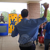 Reed Intermediate School fifth grade teacher Peter Bernson took a throw at the dunk tank set up behind Reed Intermediate School on Thursday, June 10, to plunge physical education teacher Aaron Blank into water. He aced the shot.  (Hallabeck photo)
