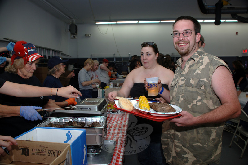 Jennifer Henion and James Riddle were eager to get through the serving line and find a seat for dinner Saturday during Sandy Hook Fire Company's Lobsterfest.  (Bobowick photo)