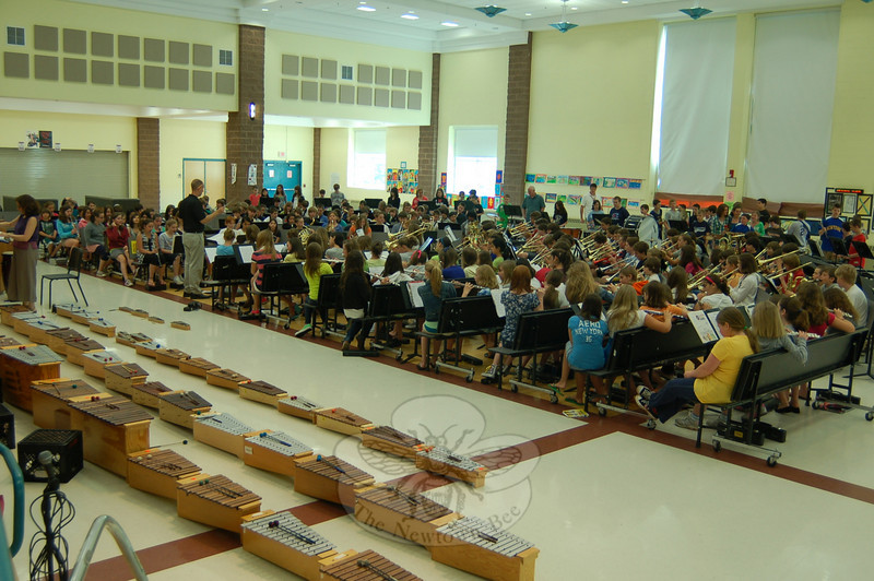 On Tuesday, June 1, the Reed Intermediate School cafetorium was full of music when the sixth grade band, orchestra, and chorus performed pieces in a round-robin fashion during first period at the school. Fifth grade students performed during second period at the school. Above, the sixth grade band performs under the guidance of music teacher Phillip Beierle.  (Hallabeck photo)