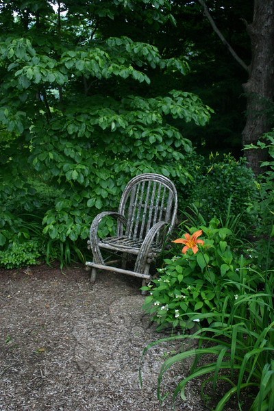 Comfortable seating can be found in a few locations within Jean Sander's woodland garden.  (Hicks photo)