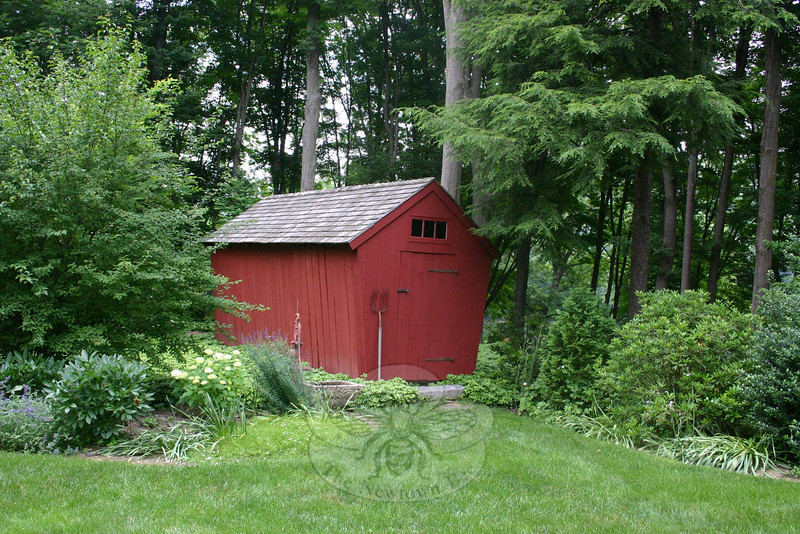 An antique corn crib was the first thing that was moved when Jean Sander decided to establish a garden on her Sandy Hook property. The 17th Century structure is now off a woodland pathway that runs along the northern edge of the property Jean and Lincoln Sander purchased in 2002 and began restoring shortly thereafter. Jean's garden will be featured on The Garden Conservancy's Open Days program on June 26. It is the only Newtown property included in the self-guided tours this season.  (Hicks photo)