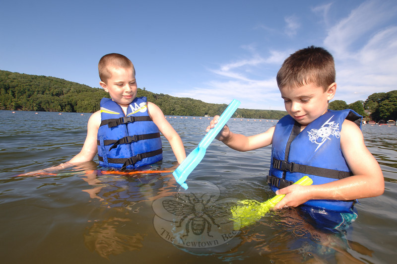Michael Giovannini, left, and his brother Joseph tested a variety of toys in the water at Eichler's Cove on Wednesday, June 30, when they splashed and enjoyed their first days of summer. Behind them is the Oxford shoreline across the Stevenson Dam.  (Bobowick photo)
