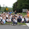 The Law Enforcement Torch Run passed by the grounds of St Rose School on Church Hill Road on Friday, June 11. Students from Sandy Hook School and St Rose School gathered in front of St Rose of Lima Church to cheer on the runners. (Hallabeck photo)
