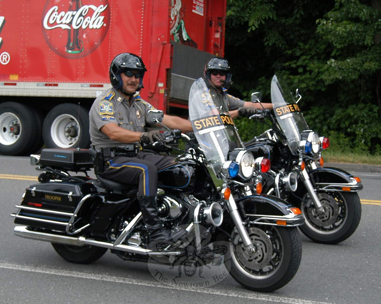 The Law Enforcement Torch Run passed by the grounds of St Rose School on Church Hill Road on Friday, June 11. State troopers were among those serving as escorts for the runners, who were en route to New Haven for the weekend's opening ceremonies.  (Hallabeck photo)