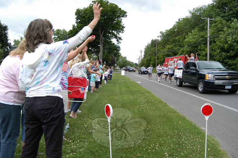 The Law Enforcement Torch Run passed by the grounds of St Rose School on Church Hill Road on Friday, June 11. Pictured there are a group of students known as the Sandy Hook School Super Stars and their teachers, who cheered on the runners. A group of St Rose School students there also watched and cheered as the runners passed by.  (Hallabeck photo)