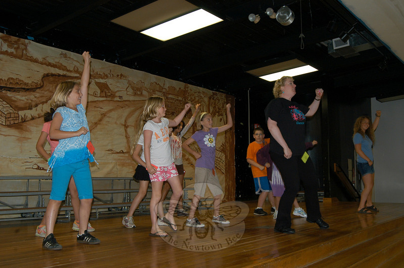 The Intro To Dance & Musical Theater, for grades three to six, SMART program through Continuing Education was underway at Head O' Meadow school on Tuesday, July 6, when instructor Michelle DeLuca, center, and Newtown High School student Megan Preis, far right, danced with students on the first day of the course.  (Hallabeck photo)
