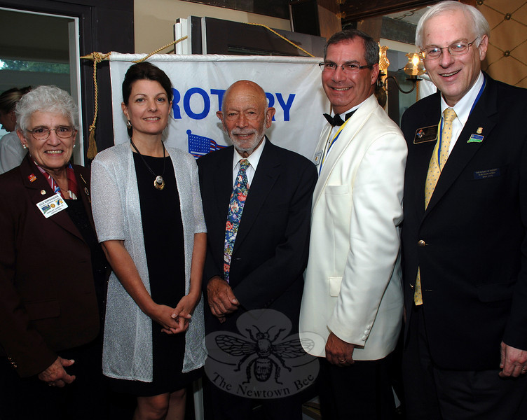 As responsibilities changed hands on June 28, Rotary officers new and old shared a dinner and drinks. From left is new District Governor Julie Reppenhagen, incoming President Carrie Swan, Robert Grossman, outgoing president William Calderara, and outgoing District Governor Colin Gershon.  (Bobowick photo)