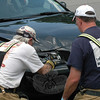 Sandy Hook Fire & Rescue Engineers George Lockwood Jr and Richard Conrod inspect the Volvo station wagon that was involved in an motor vehicle accident at Treadwell Park on June 29.  (Gorosko photo)