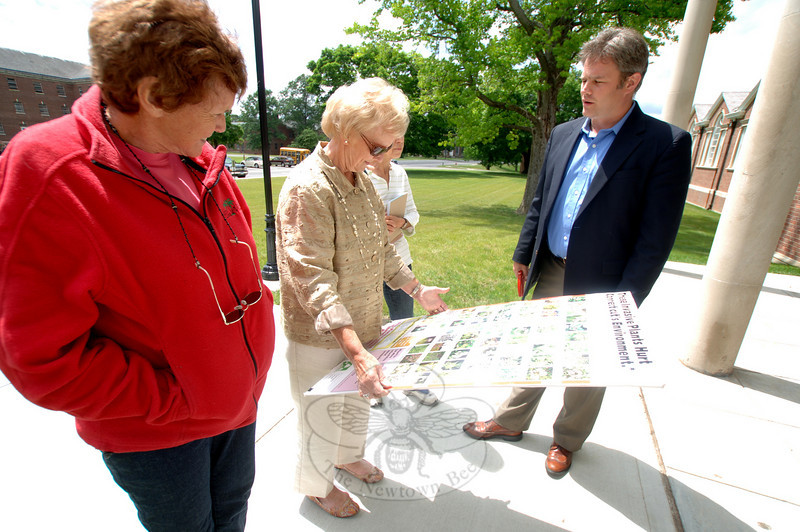 From left are Newtown Forest Association member and Conservation Commission member Martha Wright, First Selectman Pat Llodra, and Deputy Director of Land Use Rob Sibley, who talks about the invasive species listed on the board Mrs Llodra holds.  (Bobowick photo)