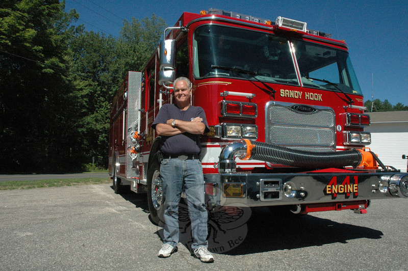 Sandy Hook Volunteer Fire & Rescue Company Chief Bill Halstead at the company's River-side Road firehouse with the new Engine 441, a fire vehicle that will play a key role in the company's emergency responses.  (Gorosko photo)