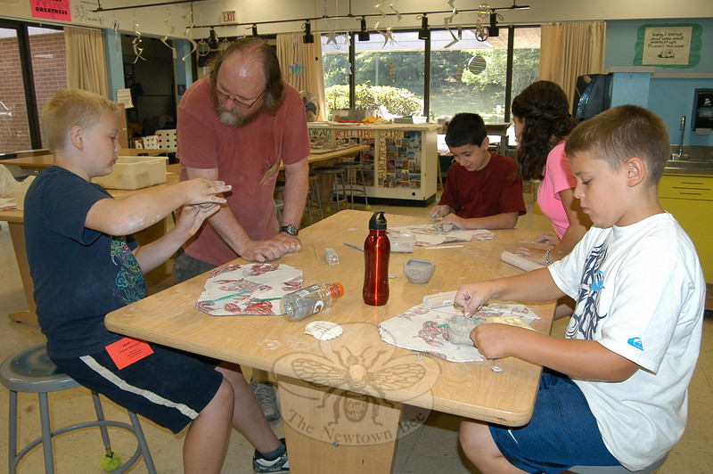 Continuing Education's The Great Clay Adventure course started the first day of the program on Tuesday, with instructor Don Kopyscinski and SMART intern Katie Peters overseeing students work on clay creations.  (Hallabeck photo)