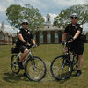 Police Officer Leonard Penna, left, and Officer Jason Flynn comprise the police department's bicycle patrol unit, which takes to the streets and hiking trails in the summertime to provide police with an extra degree of mobility in places where people are active outdoors in the warm weather. Newtown Municipal Center at Fairfield Hills is in the background.  (Gorosko photo)
