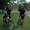 Police Officer Jason Flynn, left, and Officer Leonard Penna have started their summertime bicycle patrol work for the police department. Canaan House at Fairfield Hills is seen in the background.  (Gorosko photo)