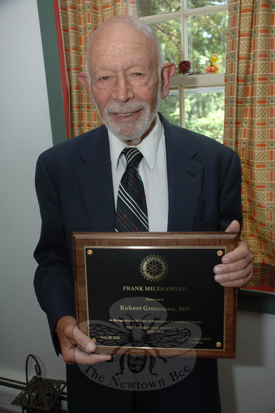 Robert Grossman, MD, displays his Frank Miles Award. Dr Grossman was presented with the honor by The Rotary Club of Newtown. (Bobowick photo)