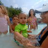 "Anne Norton cools down with her son Kyle, who will be a year-old ""in a week,"" she said. The two joined crowds of residents dunking in Treadwell Park pool this week as a heat wave baked the town.  (Bobowick photo)"