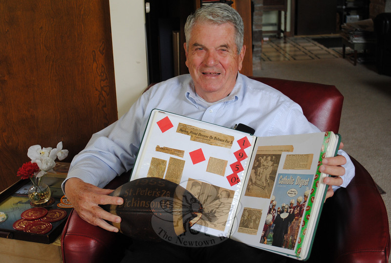Mike Hurley holds a scrapbook and pigskin from his high school days. Mr Hurley will attend two big events this fall: his 50th Reunion of the United States Marine Corps Basic School Class 4-60, and his induction into the St Peter's Preparatory School Football Hall of Fame in Jersey City, N.J., two places where he forged lasting friendships and learned lifelong lessons, he says.  (Crevier photo)