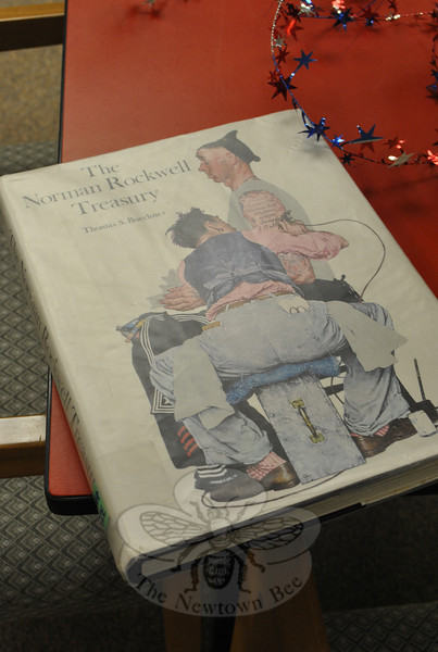 A copy of the Thomas Beuchner Norman Rockwell Treasury set up in the Community Room provided Nunnawauk Meadows residents with the opportunity to browse the art of the popular mid-1900s artist.  (Crevier photo)