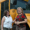 Newtown Registrar of Voters and school bus owner/operator LeReine Frampton, left, chats with local Social Services Director Ann Piccini about a planned emergency food drive being held this Saturday at three locations to help offset a serious drain on local food pantry resources. The pair hope to fill two to three school buses with donated food from shoppers at Stop & Shop, Caraluzzi's, and Big Y on July 10 between 8 am and 2 pm.  (Voket photo)