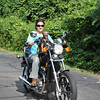 A ride on the motorcycle with his favorite person, Teresa Preziosi, is Linus's idea of the perfect moment, as can be seen by the canine grin across his face. Bee Photo, Nancy K. Crevier