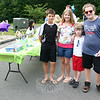 Denys Chuprenya, left, who was on vacation from Portugal, joined his cousins Tallie, Bear, and Ellie Nikitchyuk for the August 6 Walk for Wildlife fundraiser. Bee Photo, Shannon Hicks
