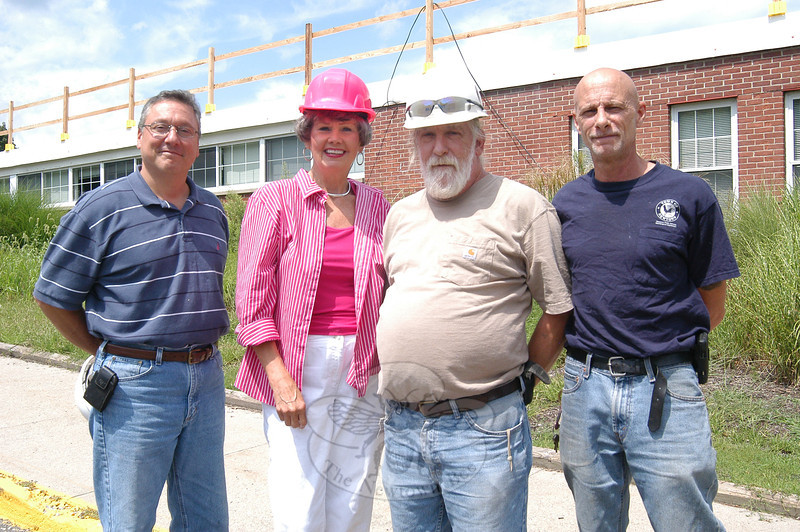From left, Newtown Public Schools Director of Facilities Gino Faiella, Newtown Middle School Principal Diane Sherlock, Newtown's Clerk of the Works William Knight, and NMS head custodian Don Roos stood together on Wednesday, August 10, outside the facility while work on the school's roof was underway. Bee Photo, Eliza Hallabeck