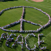 """Students and faculty at Reed Intermediate School — all 1,100 of them — created a huge peace sign and the word PEACE on the school's soccer field during Monday, September 21, morning's kickoff to a year when Reed teachers plan to continue a theme of """"Celebrate Peace All Year Long."""" This event and many others from the year in Newtown's schools were encapsulated in Eliza Hallabeck's education year in review in the January 1, 2010 Newtown Bee.  (Hicks photo)"""