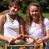 Allyson Makuch (left) and Megan Preis harvested a bumper crop from the eco-friendly garden Allyson started on The Taunton Press's South Main Street property as her senior project. This story and other memorable moments from 2009 are revisited in Nancy Crevier's year in review feature in the January 1, 2010 isue of The Newtown Bee.  (Crevier photo)