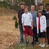 Newtown Middle School students, from left, back row, Mike Davis, Austin Raftery, Wesley Morlock, and Vivek Tedla, and, front, Matt Mossbarger and Garrison Buzzanca planted trees at Buzz's Shell on South Main Street as part of their eighth grade science project in September. The students, who have taken on the team name of Men In Green, recently learned they have won $10,000 from the Lexus Eco Challenge for their project.  (Hallabeck photo)