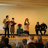 Play With Your Food presented its first lunchtime theater performance on the stage of The Alexandria Room at Edmond Town Hall on December 17. From left, in a scene from Truman's Capote's A Christmas Memory, are Sean Hannon, Kathryn Marchand, Florence Phillips, and wife and husband (and Sandy Hook residents) Kate Katcher and Don Striano.  (Hicks photo)