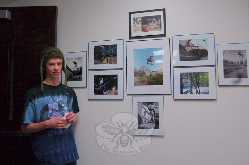 Newtown High School student Eric Hoffman with photography he took while working with photographer Laurie Klein.  (Hallabeck photo)