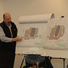 Engineer John McCoy, of JFM Engineering, Inc, of Ridgefield, speaking at a January 21 Planning and Zoning Commission meeting, described the differences between a currently proposed veterinary hospital for 164 Mt Pleasant Road, compared to a larger previously approved but never constructed building at the site that would have held retail, office, and restaurant uses. Mr McCoy represents the developer.  (Gorosko photo)