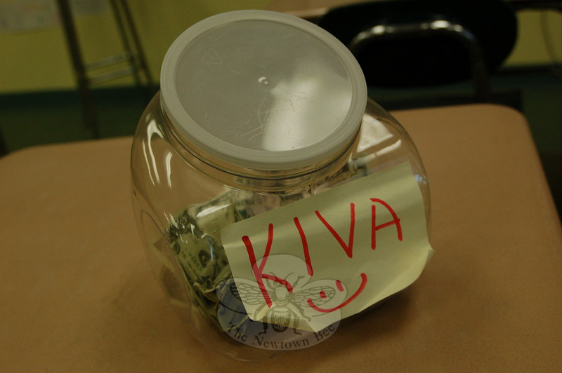 """Reed School students are leaving spare change from their lunch money in a collection bucket in fifth grade teacher Karen King's classroom. The money is then used to support microloans through a microlending website,  <a href=""""http://www.kiva.org"""">http://www.kiva.org</a>.  (Hallabeck photo)"""