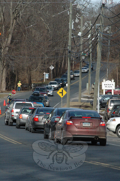 Motorists stopped for highway workers last week on a congested section of South Main Street (Route 25) near its dual intersections with Elm Drive. The Planning and Zoning Commission (P&Z) has accepted a Curb-Cut and Access Management Plan that a consulting firm prepared for several major roads in town to help the P&Z better plan for future driveway access points and to remedy traffic problems posed by existing problematic driveways.  (Gorosko photo)